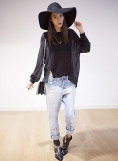 i believe in a big black hat.