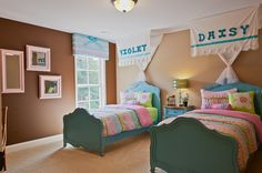 This bedroom is perfect for girls sharing due to its size and adorable blue bed frames. | Fischer Homes