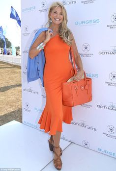 Christie Brinkley shows off her orange Soft Ricky bag at the Bridgehampton Polo Club 17th Season event in The Hamptons