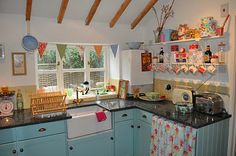 A cottage kitchen with pretty aqua cabinets