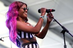 Proof That Purple Hair Was Always Awesome #refinery29  http://www.refinery29.com/celebrity-purple-hair#slide1  Azealia Banks rocked out in a pink-and-purple mane at Coachella in 2011.