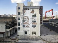 in Lisnave by Vhils (Alexandre Farto)