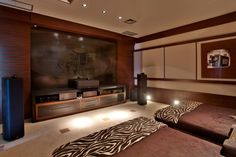 """Love that that """"movie room"""" has two huge bed-couches. LOVE.   Residence CF by PUPO + GASPAR Architecture & Interior"""