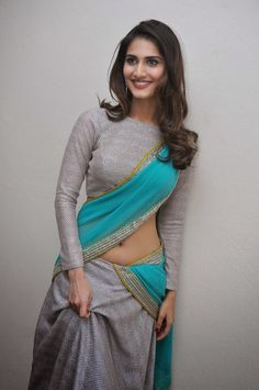 Well this is new! A silver and sky blue half saree with a full sleeve high neck blouse - MinMit Clothing