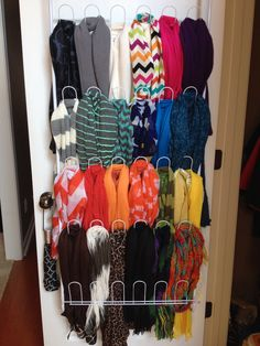 Over-the-door metal shoe rack used for organizing scarves, hats, purses, etc. This was an idea I saw on Pinterest a while back. So I asked for the rack for my birthday so I could tackle the scarf disaster I had going on. Only took me 10 minutes to organize them by length and color. I am so happy with how it turned out!! Thanks to whomever thought of this ingenious idea first!