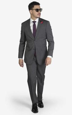 Suit includes jacket & trousers 2-button single breast jacket Notch lapels Flap pockets Side vents Suit includes jacket & trousers Fit: Slim Fit Comfort: Stretch Armhole for comfort Material: 98% Wool 2% Spandex Color: Medium Grey Houndstooth