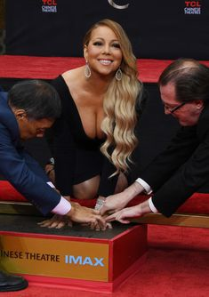 Mariah Carey Photos - Mariah Carey is honored with a hand and footprint ceremony at the TCL Chinese Theatre in Hollywood, California on November 1, 2017. / AFP PHOTO / Mark RALSTON - Mariah Carey Hand and Footprint Ceremony