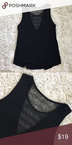 Black Tank Top w/ Lace This black tank top has a see-through lace design on both the front and back. Perfect for dressing up with jeans and heels or to dress down with colored shorts. Excellent condition, hardly worn. Size: S Red Haute Tops Tank Tops
