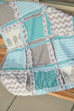Rag quilt style Elephant Crib Bedding in blue and gray with Chevron and Elephant prints. A beautiful crib bedding for a Jungle Themed Nursery and a great Gender Neutral Nursery! The Modern Blue and Gr