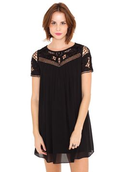 Who said details don't matter? They're everything! ;)<BR>Black tunic dress with short sleeves.<BR>Crochet yoke and sleeves with metallic details and sequins.<BR>Round neck with same colour border trim.<BR>Creases on the chest.<BR>Same colour interior lining.<BR>Fabric with silky texture.