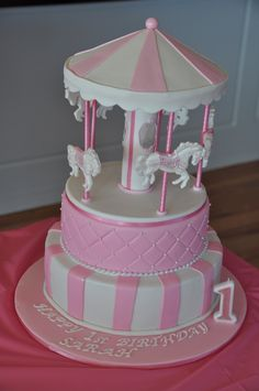 Carousel cake - I made this cake for my daughter's first birthday.  I opted to make the top of the carousel from cardboard rather than cake as I wanted to make it in advance.  I was going to use RKT.  The carousel is covered in royal icing and then RTR.  The horses are made from RTR and are hand painted.
