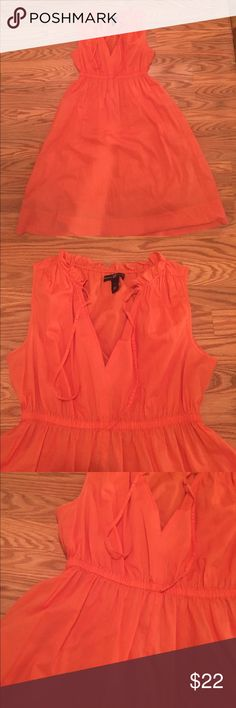 "GAP summer dress- MAKE AN OFFER! Worn 2x this salmon color is true tonpic. Light airy cotton, but lightly lined to prevent see-thru. This is the perfect dress for ""everything "" you have planned for the summer. Pretty feminine ruffling at neckline. I am 5'3 and this falls right below my knee. GAP Dresses"