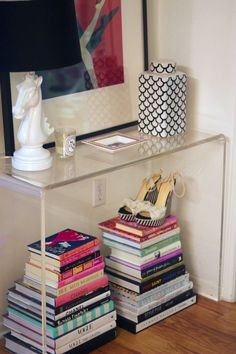 I like this idea for an entryway or even a vignette in my master suite (fashion books and magazines beneath, jewelry and favored accessories on top).
