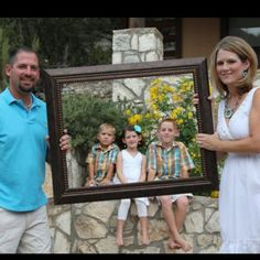 family picture- I've seen the frame idea many times, but I like that the parents are holding it from the outside