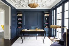 Navy blue office with custom built-ins, gold chandelier, and moulded ceiling   City Homes Design + Build