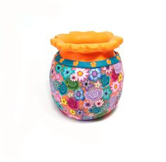i love the floral and colors, this vase made me think of something that i could possibly make on the wheel
