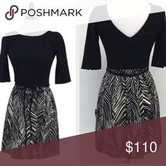 Milly black & tan print dress Beautiful and classy dress from Milly. Excellent condition, worn once. Cotton/Viscose/Polyamide/Elastane/Acetate. Lined. Made in the USA. Concealed back zip. V back. No belt. 3/4 sleeves. Slits on sleeves. Pockets. Length from shoulder is 31\