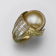 Mabé Pearl and Diamond Swivel Ring Mounted In 18 Gold, Signed Carimati