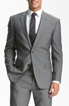 I love the idea of the groomsmen in grey suits.  I think black might look a little stark with the deep royal blue, and the grey would look great with blue ties.