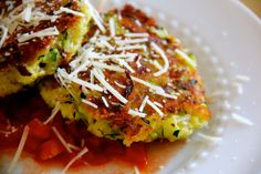 Try these Zucchini Cakes with mozzarella and parmesan this zucchini season!