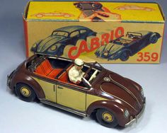 CKO VW Toys - This is an Oval Windows Beetle released from the CKO of Germany in the 1950s.   Changes instantaneously to a closed and open type lever on the chassis type by the operation.