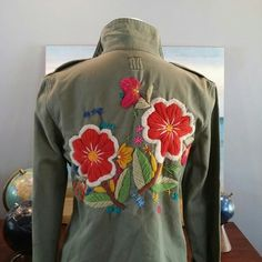 Lucky Collection Embroidered Military Jacket L EUC This is unique, has the look of a military jacket that patches were removed from. The back has gorgeous embroidered florals. Lucky Brand Jackets & Coats Jean Jackets