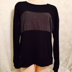 Black and Gray top-stretchy Stretchy long sleeves top, 95% rayon and 5% spandex. Tops