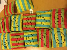 Bean bags for throwing to make maths fun for those active children, may also help a child start recognising or noticing numbers if they have a transporting or trajectory schema