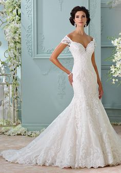 Off-the-shoulder embroidered Venise lace appliqué, tulle and organza over satin trumpet gown with illusion lace cap sleeves, deep sweetheart neckline, illusion lace low back bodice with crystal button closures | David Tutera for Mon Cheri | https://www.theknot.com/fashion/116201-aura-david-tutera-for-mon-cheri-wedding-dress | https://moncheribridals.com/collections/wedding-dresses/david-tutera-for-mon-cheri/?utm_source=theknot.com&utm_medium=referral&utm_campaign=theknot&utm_content=gallery