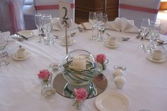 Dusky pink roses and fish bowel table centre