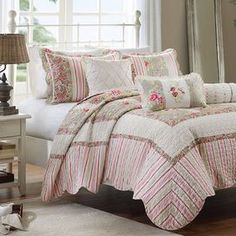 """Showcasing a feminine floral and stripe motif and delicately scalloped edges, this charming coverlet set brings cottage-chic flair to your bedroom.   Product: Full/Queen: 1 coverlet, 2 standard shams and 3 decorative pillowsKing: 1 coverlet, 2 king shams and 3 decorative pillowsConstruction Material: CottonColor: Pink and whiteFeatures: Decorative pillows include insertsDimensions: Standard Sham: 20"""" x 26""""King Sham: 20"""" x 36""""Quilted Decorative Pillow: 16"""" x 16""""Floral Decorative Pillow: 16"""" x…"""