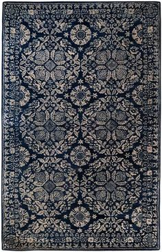 This stunning wool rug is hand-tufted for added comfort and texture. The beautiful floral design will look amazing with may different styles of decor and in just about any room in your home.