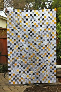 Want to make one of these postage stamp quilts!