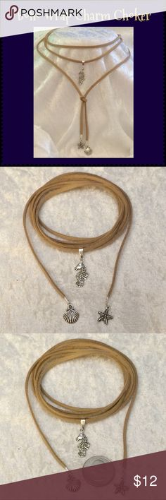 """Sand Vegan Suede Boho Wrap Beach Charms Choker 61"""" This sand vegan faux suede 3/8""""W beach-themed boho wrap choker is 61"""" long. Antique Tibetan silver seahorse, seashell & starfish charms. Can be worn/tied many ways or as wrap bracelet. Handcrafted by me.   Can be made longer or shorter. 21 colors available. For different color/charms tag me for custom order.  Jewelry items priced firm as single purchase due to material cost & PM fees.   Bundle special on guitar pick/choker/charm jewelry…"""