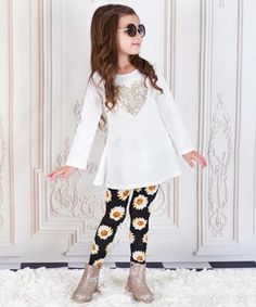 Another great find on #zulily! Black & White Daisy Siena Tunic &…