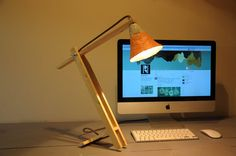 Look & Feel __________ Desk lamp handmade from recycled materials. The minimalistic design of this lamp is what sets this lamp apart from the