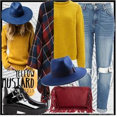 A bold 70s inspired outfit with check print blanket cape, ripped jeans and mustard knit jumper