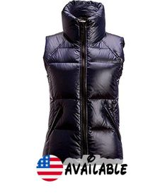 B01JOBGQJO : SAM. Women's Metallic Freedom Down Puffer Vest In Midnight (Navy Blue) Size X-Small. Fits true to size.. Stand collar zip front fleece-lined pockets with zip closure.. Channel quilted lightweight and packable.. Shell and lining: nylon; fill: white goose down/feathers.. Dry clean. Imported.