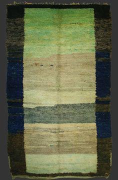 Beni Mguild pile carpet, western Middle Atlas, Morocco, ca. 1930, ca. 245 x 145 cm (8' 2'' x 4' 10'')