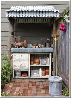 Add a little roof and a brick floor and you pretty much have a potting bench garden room. Isn't this a sweet set up from Fishtail Cottage. Potting Station, Le Hangar, Greenhouse Shed, Potting Tables, Patio Interior, Brick Flooring, Potting Sheds, Summer Diy, Homestead Survival