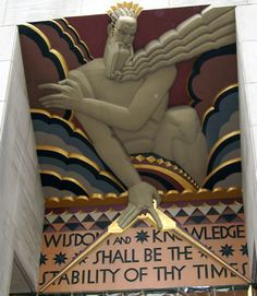Portion of 'Wisdom, Light and Sound' by architect Lee Lawrie, located above the entrance of 30 Rockefeller Center (GE Building), NYC. The sculpture, depicts a gnostic demiurge holding a Masonic compass. Art Deco