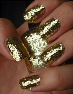 gold glitter nails.