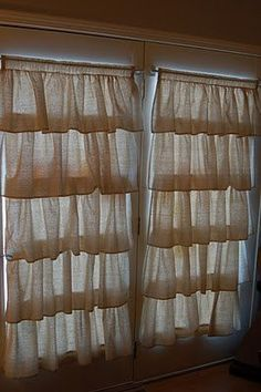I'm thinking a single ruffle at the top of the curtains using clip rings so that the ruffle isn't actually sewed to the base curtain. A bit more flexible for changing things up down the road. Also could add cute pom-pom fringe to ruffle.
