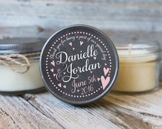 Colors and fonts can be changed to suit! Personalized soy candles are a wonderful way to say thank you to your guests. All candles are handmade in Paso Robles, California. Your order includes the following: ***Set of 12 - 4oz size mason jar - Soy Candle Favors with Custom Label included. Dimensions: 4oz Mason Jar Candle: 2.75 (widest point) x 2 includes 2.5 label ***Your choice of scent and jute tie or black or white grosgrain ribbons. Also, custom ribbon available (please contact first)…
