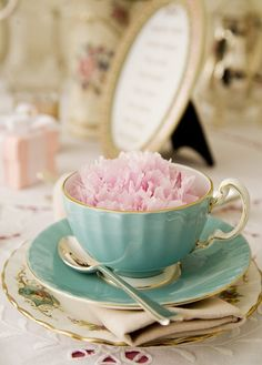 Peonies in vintage teacups will be scattered on the guest book table and dinner tables on top of vintage books.