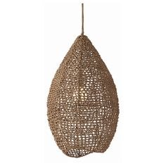 """H: 27in Dia: 15in Hand woven sea grass in its natural coloration forms a graceful teardrop shade. A single bulb floats inside its own hive. Shown with a 4"""" fros"""