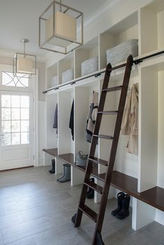 large mudroom with ladder for those hard to reach places + it looks stylish. #mudrooms