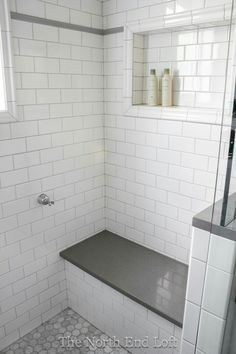 We chose shiny white subway tile with light gray grout for the walls, with an accent line of gray tile. We chose shiny white subway tile with light gray grout for the walls, with an accent line of gray tile. Upstairs Bathrooms, Laundry In Bathroom, Basement Bathroom, Remodled Bathrooms, Bathroom Storage, Rental Bathroom, White Bathrooms, Budget Bathroom, Bad Inspiration