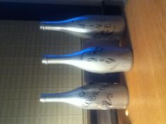 Easy craft with wine bottles I found on Pinterest and then I added scrapbook stickers :)