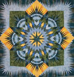 The Hawaiian Star/Prairie Star Pattern was designed by Judy & Bradley Niemeyer.  This was the very first Judy Niemeyer quilt I completed and was the beginning of my love of paper piecing  and Judy's designs.  It was quilted by Linda Bevins of Nottingham, NH.